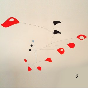 red black hanging mobile sculpture art calder