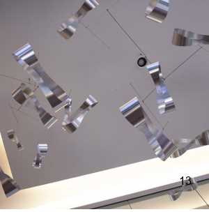 silver reflective corporate lobby hanging mobile art