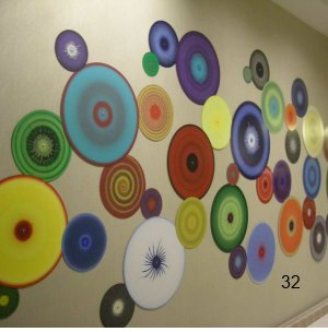 rainbow multi-color wall installation painted discs